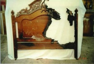 A fire-damaged walnut headboard.