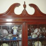 Dentil – The square block molding near the top of this cabinet is called dentil molding.