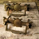 You should remove your brass hardware, such as these antique brass drawer pulls, before cleaning.