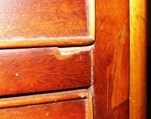 This veneer problem is not a veneer problem at all. It is a drawer problem. The drawer must be fixed before the veneer can be fixed.