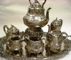 A seven-piece silver tea service in the Teniers pattern by Paul Storr.