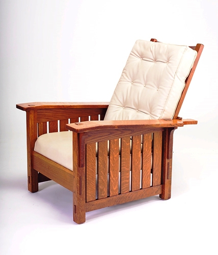 An original Gustave Stickley recliner. The seats have been recovered; originally they would have been dark brown/black.