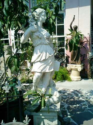 A 19th-century cast stone statue of Diana the huntress, virgin goddess of the hunt, atop a cast stone pedestal. While statuary can add to the beauty of your garden for most of the year, outdoor art should be brought inside during winter months if possible.