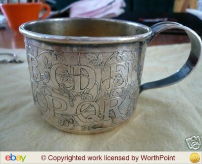 This Sterling silver Art Nouveau-style baby cup by Gorham features an ABC motif. It realized $152.50 in an auction on eBay.