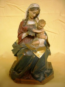 And Italian carved and painted Madonna and Child, marked M.K. Kaslatter.