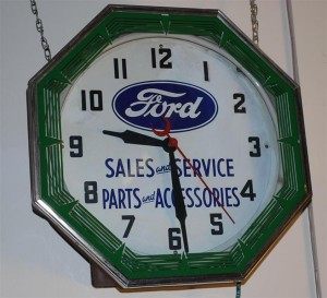 An original Ford Sales and Service Parts & Accessories octagonal neon clock.