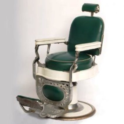 An early 20th-century barber's chair, made by Theo A. Koch.