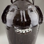 Lot 58 - 5 gallon face jug