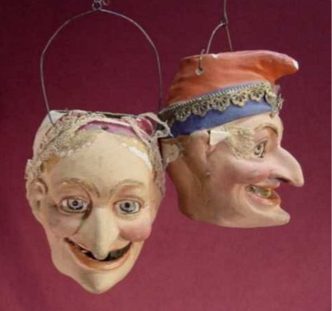 This pair of antique German paper mache Halloween Jack 'O Lantern brought $4,494 at auction.