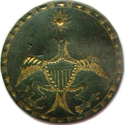 A version of the 1400 or so different brass buttons sold to the public to commemorate the first Inauguration of George Washington on April 30, 1789. It was sewn onto vests and coats and is why we have campaign buttons today.