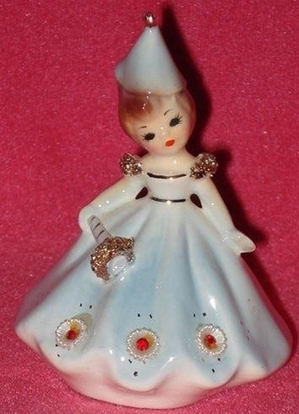 "A 4-inch porcelain ""doll of the month"" by Josef Originals dates to the 1950s. The January figurine was dressed with New Year's Eve embellishments. This one sold for $30 in November 2016."