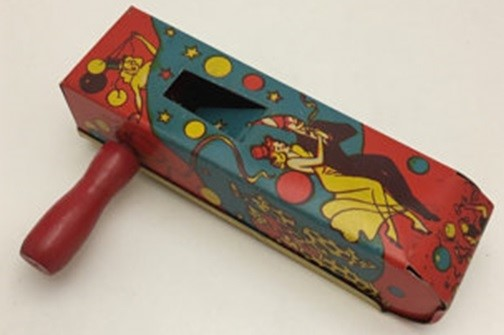 Vintage noisemakers are plentiful on the secondary market but very few have a true New Year's Eve theme. This 1940s tin lithographed ratchet by U.S. Metal Toy Co. is a good example with classic illustrations of the holiday.