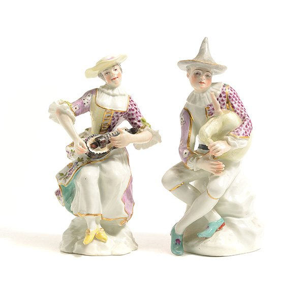 This pair of 18th-century porcelain musicians are very makred with the royal shield mark and are highly sought after.