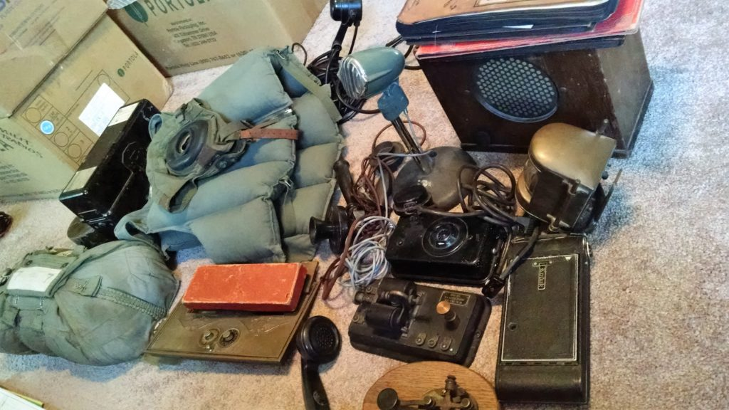 My consignor unpacked his collection, and laid them out on his den carpet. Lots of Bakelite, including hand-held radio speakers, radio receivers that were mounted on the bulkheads of the lower decks of ships, or in the cockpits of fighter planes.