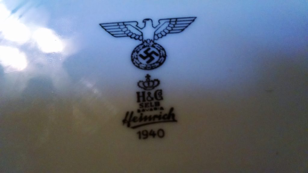 There were also numerous pieces of heavy china pieces made in Germany, some with swastika markings, others with abbreviated markings that indicated if it was made in occupied Germany, Belgium or someplace else.