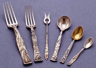 A Tiffany & Co. sterling silvers flatware place setting in the Vine pattern