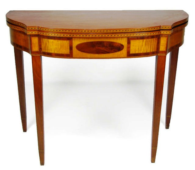 An example of a mahogany card or gaming table with one board top from the late 18th century. The table has stitch inlay on the edge of the leaves and cuffing on the tapered legs. The secondary woods are poplar and white pine. The table is believed to Salem, Massachusetts-made, circa 1790.