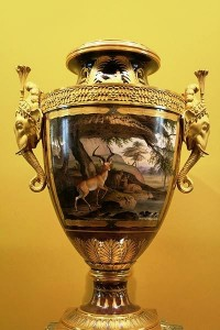 One of a pair of Clodion vases, made at Manufacture Royale de Porcelaine de France, and given by Louis XVIII of France to Monsieur, his brother, future king Charles X. Hard-paste porcelain and gilt bronze, 1817.
