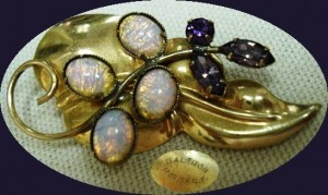 A pretty leaf-adorned pin/pendant with opals and faceted amethyst-color stones. Cleverly styled, this piece, circa 1950, is lovely worn at any angle.