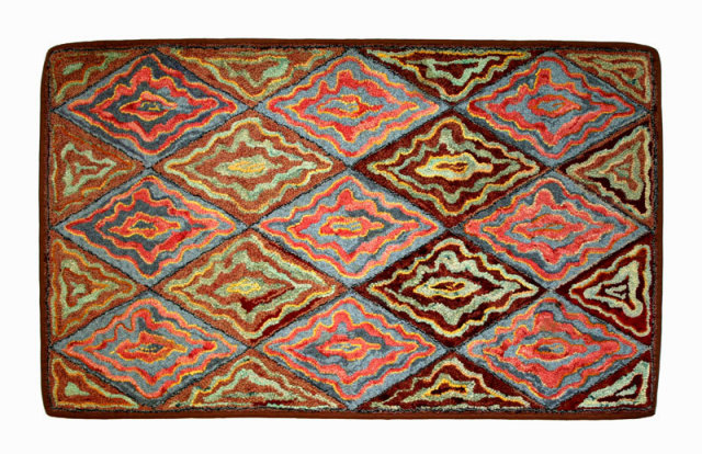 Unusual, distinctive, creative, pattern of diamonds and triangles of undulating lines, finely hand hooked, wool on burlap, circa 1920.