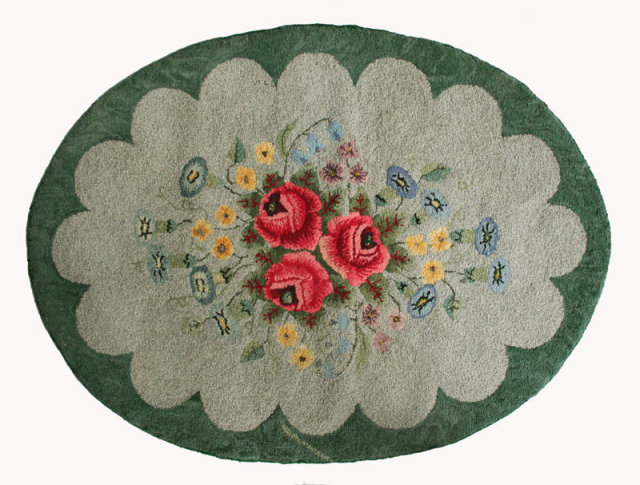 Hand hooked oval rug made of wool on burlap in floral design, circa 1940.