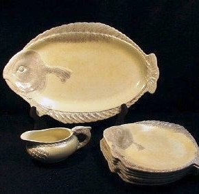 An English wartime ceramic fish platter, luncheon plates and a sauce boat, produced by Burgess & Leigh Ltd., Burslem, England.