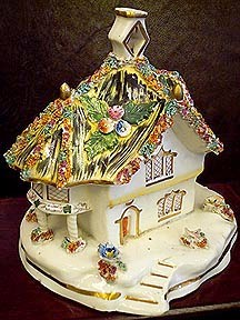 A 19th-century English Staffordshire pastille burner in the shape of a thatched-roof cottage with, circa 1850.