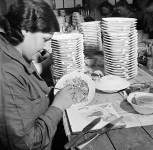 A ceramics worker paints a design onto a plate with enamel at the J & G Meakin factory in Hanley. These plates were to be exported to South America to generate income for the battered British economy during World War Two.