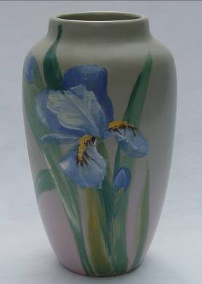 Chips on the top rim of this Weller Art Pottery vase were professionally and invisibly restored by Old World Restorations, Inc., Cincinnati, Ohio.