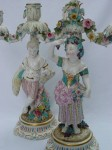 Pair of early porcelain candlesticks with old discolored repairs, small chips and missing leaves. This damage is difficult to see on a photo posted on an Internet listing.