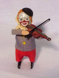 "An antique Schuco Clown playing a violin, stands about 4 3/8 inches high and is marked ""Schuco Patent"" on the side of one foot and ""Made In Germany"" on the side of his other foot."