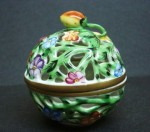 This globe Herend box is hand painted and done in pierced style with a floral decoration, circa 1900.