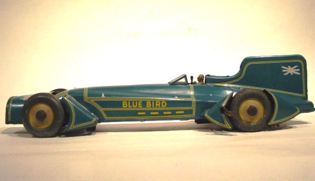"A German-made Guntherman ""Blue Bird"" Land Speed Car in good working order. This tin lithographed wind-up car is 20 inches long and features sporty Art Deco detailing. Circa 1930."