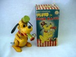 "A vintage Linemar Toys Japan Walt Disney Productions Mechanical ""Pluto the Drum Major"" with his original box. Pluto is made of tin and is marked on his back: Linemar Toys Japan Copyright Walt Disney Productions."