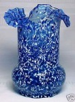 A cobalt blue glass celery vase with a tri-fold fluted ruffled edge, circa 1898-1906.