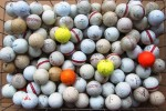 One lot of 155 used golf balls. Some are used more than others, and there may be logo'd balls in there.