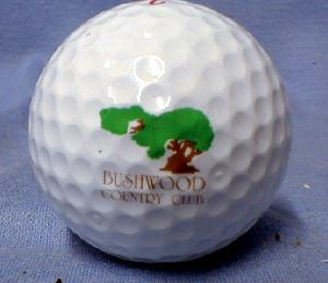 A golf ball with the Old Bushwood Country Club logo.