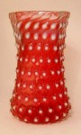 A 7-inch hobnail and opalescent cranberry celery vase by Hobbs and Brockienier, circa 1870-1897.