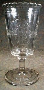 An example of an early American Pattern Glass celery vase. This over-sized goblet with crimped lip, in the Venus & Cupid pattern, was produced by Richards & Hartley between 1875-1884 and by U.S. Glass after 1891.