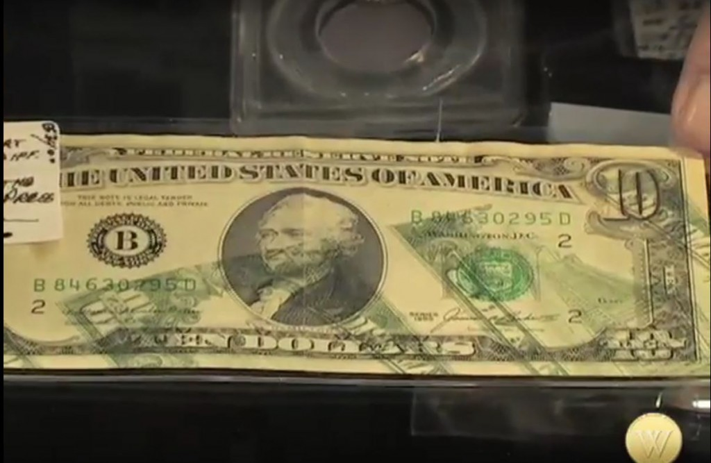 A $10 bill with the reverse accidentally printed on the front. It is worth $4,500 because of its condition.