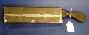 "This amputation saw was found with the tin ""scabbard"" protecting the blade, circa 1860."