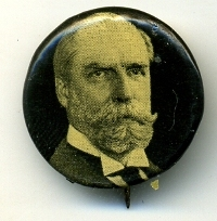 1916 Charles Evan Hughes button, from the front the button appears near perfect but when viewed from the side, much of the collet on the right hand side is exposed.