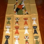 Tammis Keefe did a series of linen towels and handkerchiefs with dog and cat themes. This momma cat and her kittens came in several different color schemes.