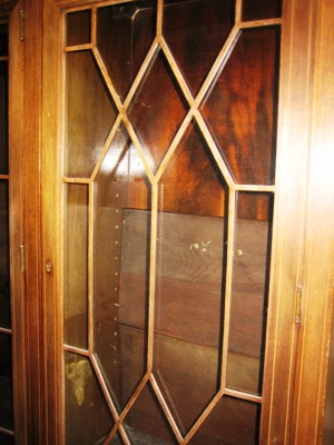 Muntin – The thin plywood grill over glass in 20th century bookcases is meant to simulate the small pieces of wood that originally held individual panes of glass. It is called a muntin.