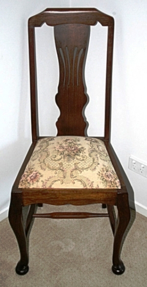 Splat – The splat in this stylized Queen Anne chair is said to be pierced, unusual for the style.
