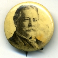 This 1908 William Howard Taft button has very slight staining to the right of his head. It could almost be mistaken for shading by the artist.