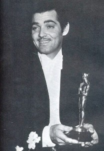 "Clark Gable accepting one of his three Oscar (""It Happened One Night,"" ""Mutiny on the Bounty,"" and ""Gone With The Wind."""