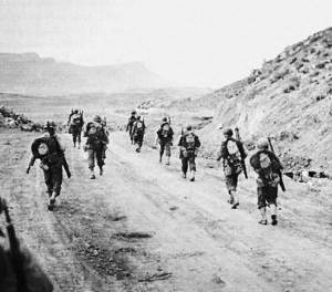 U.S. soldiers on the march during the Battle of Kasserine Pass.  (Public Domain)