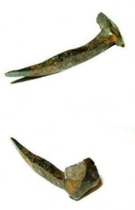 "These are hand-made iron nails from the 18th century. Note the ""rosehead"" hammered head and the sharp point."