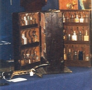 Brown-painted, carpenter-made apothecary chest with hand labeled bottles, which sold for $1,100 in 1999.